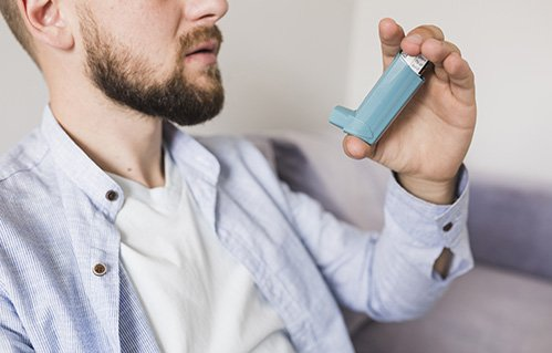 Man holding inhaler